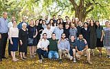 Baar-Ilan University Professor Arie Zaban, left, with administrators and participants in the Summer Science Research Internship Program, including Jacob Rosenberg, middle of front row, Zachary Friedman, behind him in black shirt, and Rachel Retter, in front of the tree. (Faith Baginsky)