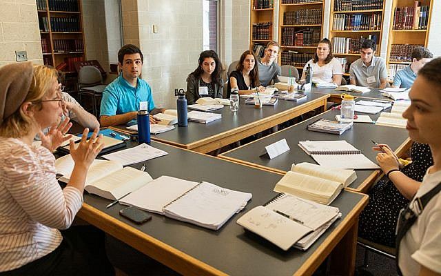 Students sit around a seminar table at the Maimonides and Tikvah Scholars retreat.