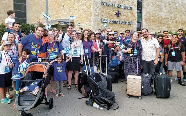 Newly arrived olim show their elation after landing in Israel.