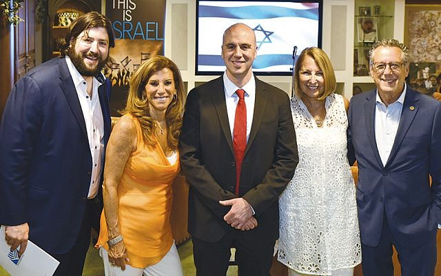 Noah Marcus, left, Israel Bonds assistant executive director, joins Sharon Sasson, chair of Rockland Women's Division; Sgt. Benjamin Anthony, founder of Our Soldiers Speak; Rockland general chair Cathy Distelburger; and Lee Schwartz, executive director of Israel Bonds NJ & Rockland. (Jeff Karg)