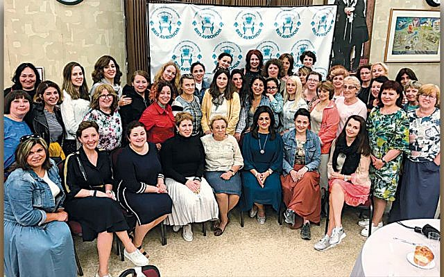 Shterney Kanelsky, Bris Avrohom's associate director, seated third from right, is surrounded by emissaries and guests. (Courtesy Bris Avrohom)
