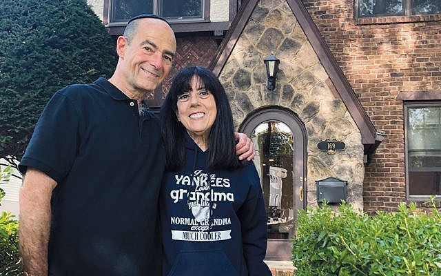 Richard and Ellen Gertler stand in front of their Teaneck house. (Jamie Janoff)