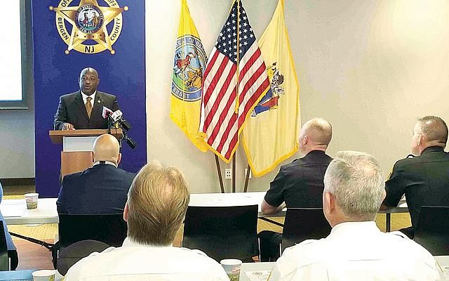 Sheriff Anthony Cureton opens the conference on security.