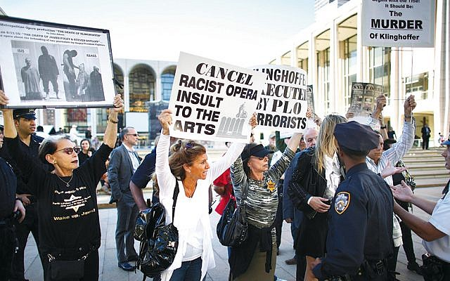 """Demonstrators in New York protest the Metropolitan Opera's decision to produce """"The Death of Klinghoffer"""" in 2014. (Raffi Wineburg)"""
