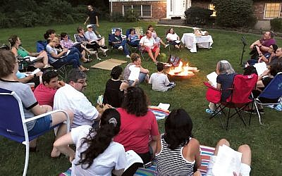 On Tu b'Av — it started on the evening of August 15 this year — people gathered around a bonfire in front of Rabbi Scheff's house on the Orangetown Jewish Center campus as evening drew in. (Rabbi Craig Scheff)