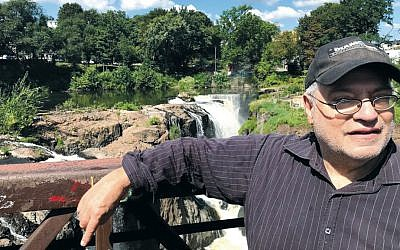Bob Dickstein, who lives at the Federation Apartments, attends the Paterson Shul's Tashlich last year at the Great Falls. (Courtesy Jerry Schranz)