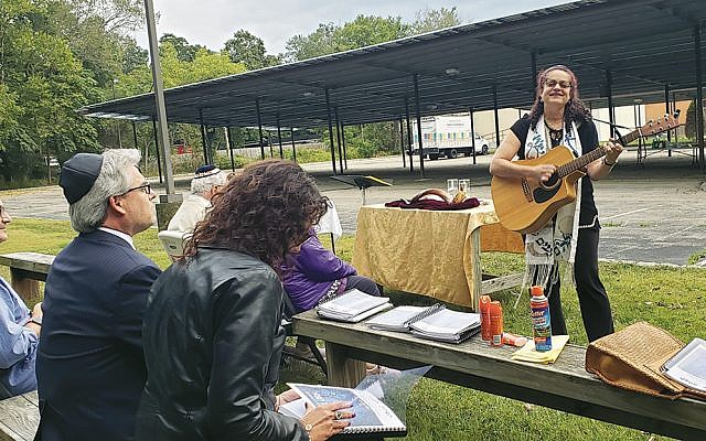Rabbi Meeka Simerly accompanies a Shabbat Under the Stars service at Temple Beth Tikvah on September 14, leading into the introspection of the High Holy Days. (Courtesy TBT)