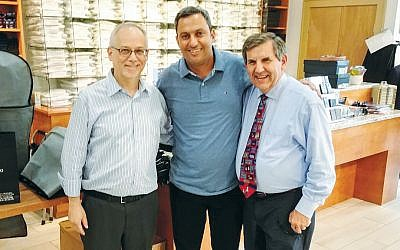 Sam Rappaport, at left, and Andy Jaffe of Emporio flank Mayor Alon Davidi of Sderot. (Courtesy Emporio)