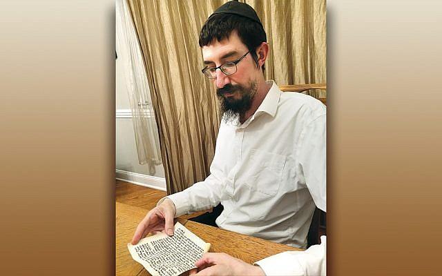 Rabbi Mendy Kaminker of Chabad of Hackensack checks a mezuzah scroll. (Photo provided)