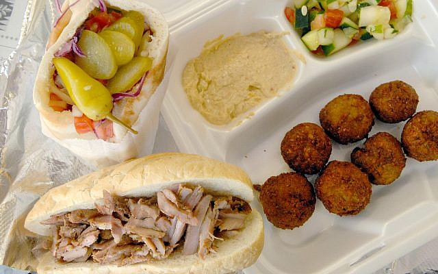 A shawarma platter with falafel and hummus (Katherine Frey/The Washington Post/Getty Images)