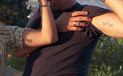 Hunter Biden and Melissa Cohen Biden show off their matching Hebrew tattoos. (Screenshot from ABC News)