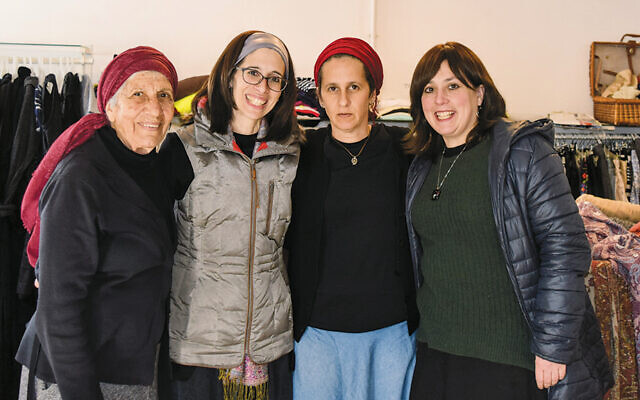 Karen Milch Thayer, second from left, and Jessica Katz, right, with volunteers at a Yad Leah thrift shop in central Israel.