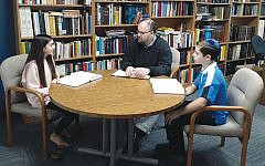 Rabbi Joshua Finkelstein teaches text to Lexi Bernstein and Brandon Sherwood, who are charter members of the new Hebrew Chai. (Joshua Finkelstein)