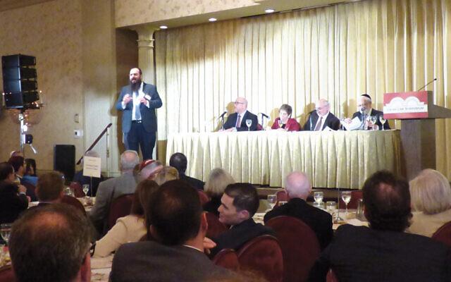 Rabbi Shalom Lubin speaks to the symposium. (Miryam Z. Wahrman)