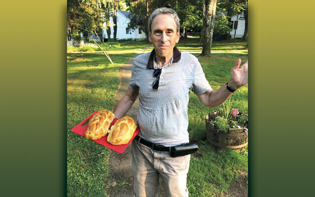 Gerard Soffian shows off the fresh-baked challah he made at Charles Rubin's challah workshop.