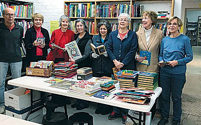 Members of the Friends of the Englewood Library prepare children's books for the sale. (Photo provided)