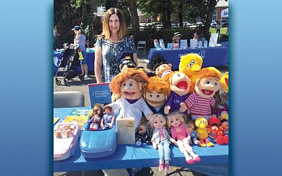 Suzanne Berman sold dolls and toys to the many families who stopped by her table.  (Courtesy Temple Beth Sholom)