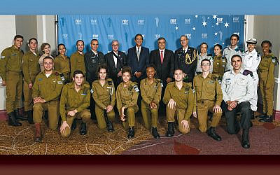 From back row, sixth left, Maj. Gen. Yoel Strick of the IDF, former head of the Northern Command and now commander of the ground forces; FIDF president Bobby Cohen; FIDF chair Rabbi Peter Weintraub; FIDF national director and CEO Maj. Gen. (Res.) Meir Klifi-Amir; Israel defense and armed forces attaché to the United States Maj. Gen. Yehuda Fox; and a delegation of 20 IDF soldiers at the 2019 FIDF National New York Gala Dinner. Sgt. Aaron, a lone soldier from Paramus, is in the front row, left. (Shahar Arzan)