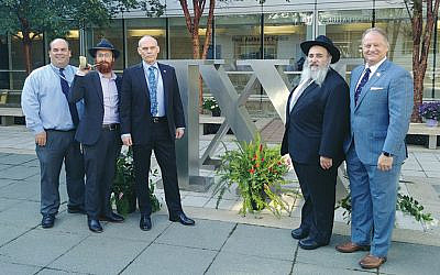 Frank Radics, Rabbi Avremy Kanelsky, Doug Stearns, Rabbi Mordechai Kanelsky, and Ronald Shindel. (Courtesy Bris Avrohom)