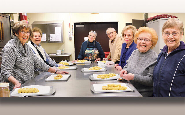 Seniors gather to bake challah last week.