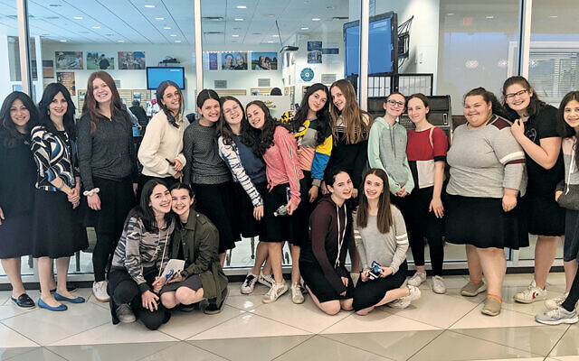 Students from Ma'ayanot High School for Girls in Teaneck have been working with members of Senior Source to introduce them to technology. (Ma'ayanot)