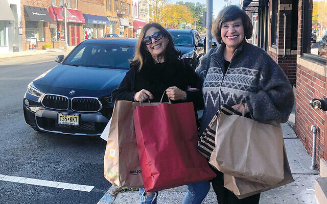 Franci Steinberg, left, the president of Temple Sinai's sisterhood, and Elizabeth Halverstam, co-president of the Bergen County section of NCJW, get ready for the Dean Street Stroll; logically enough, they are on Dean Street.