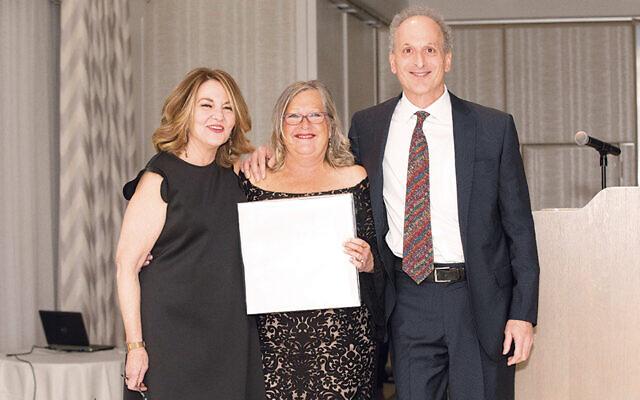 Susan Greenbaum, Beth Janoff Chananie, and Jamie Janoff; left, the award  they received.