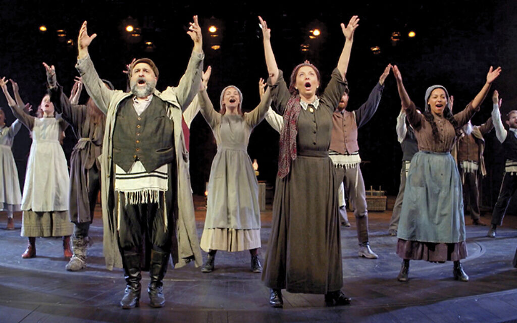 """The full ensemble sings """"Tradition!"""" at the Chicester Festival Theater in England. (CHICHESTER FESTIVAL THEATRE)"""