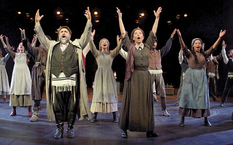 "The full ensemble sings ""Tradition!"" at the Chicester Festival Theater in England. (CHICHESTER FESTIVAL THEATRE)"