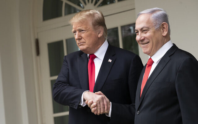 President Donald Trump and Prime Minister of Israel Benjamin Netanyahu shake hands while walking through the colonnade prior to an Oval Office meeting at the White House March 25, 2019