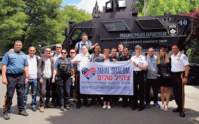 Visitors from Zahal Shalom visit the Paramus police department in 2018. (Johanna Resnick Rosen)
