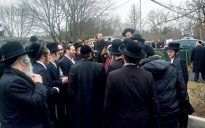 A crowd of Orthodox Jews gathers outside Rabbi Chaim Rottenberg's house. (Photos by Ben Sales)