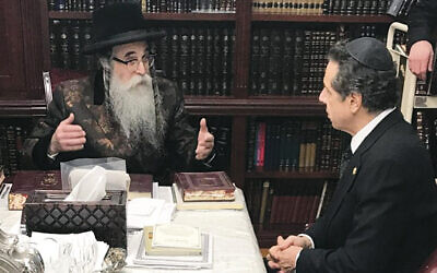 Rabbi Chaim Rottenberg meets with Governor Andrew Cuomo after the attack. (OJPAC)