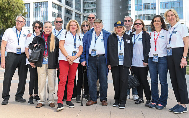 Inna Needelman, in sunglasses, third from right, and her husband, Joshua, behind her, of West Nyack went to Israel with the FIDF. (Shahar Azran)