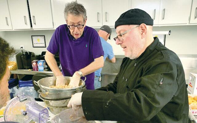 Howard Forer and Gordon Remer make latkes. (Photo by Bob Berliner Courtesy GRJC)