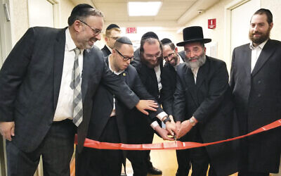 Among those pictured, from left, are patient liaison Rabbi Joel Fried, Alaris chaplain Rabbi Chananya Kaner, Chesed 24/7 operations manager Yossi Greenberg, and Chesed 24/7 CEO Rabbi Sholom Greenberg.