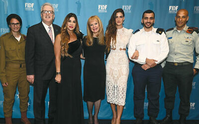 From left, Sgt. Anael; FIDF New Jersey director Howard Gases; master of ceremonies Siggy Flicker; dinner co-chair Annette Tauber Stern; the guest speaker, Israeli TV and film star Rona-Lee Shim'on; Sgt. Maj. Tal; and Lt. Col. Sharon. (Photo courtesy Shahar Azran)