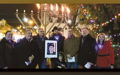 Westwood Council members Erin Collins and Christopher Montana, left, with mayor-elect Raymond Arroyo, Rabbi Yosef Orenstein of Valley Chabad and his son, Mendel, Westwood Mayor John Birkner, and council members Robert Bicocchi and Beth Dell. (Courtesy Valley Chabad)