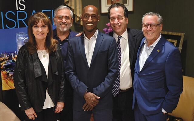 Ruth and Bruce Pomerantz, event hosts, left, with guest speaker Daniel Sahalo, Israel Bonds registered representative Marc Rosen, and Israel Bonds' executive director, Lee Schwartz. (Jeff Karg)