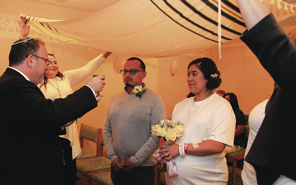 Rabbi David Fine performs the wedding that united Anlly Marin and Javier Delgado at Valley Hospital in Ridgewood. (JOHANNA RESNICK ROSEN)