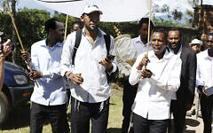 Men of the Arusha Jewish community carry their sefer Torah to its new home. (STEFANIE DIAMOND)