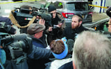 Yossi Steinmetz describes the shootout to reporters.