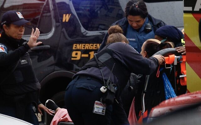 A woman receives medical assistance at the scene of a shooting in Jersey City, N.J., Dec. 10, 2019. (Kena Betancur/AFP via Getty Images)