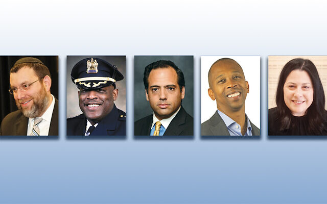 Rabbi Chaim Poupko, left, Sheriff Anthony Cureton, Michael Cohen, Walter Mosely, and Sarri Singer