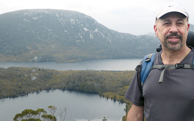 Rabbi Barry Schwartz pauses during his trek in Tasmania.