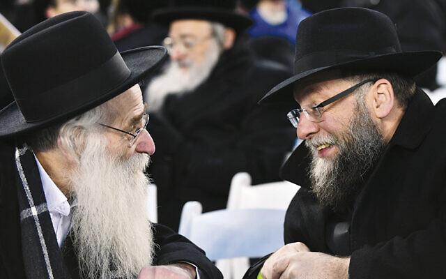 Two participants at Siyum HaShas at MetLife Stadium. (Moshe Gershbaum and Chaim Schwartz/Agudath Israel of America Archives)
