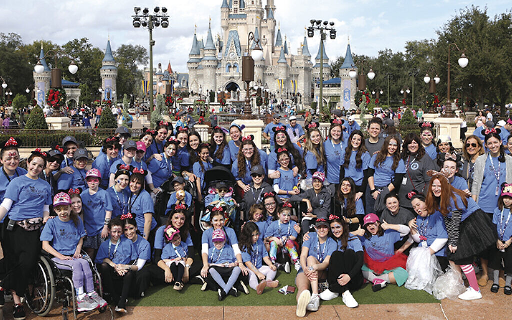 Everyone gathers in the Magic Kingdom. The trips are free; every child has his or her own counselor, and a support staff backs it all up. Everyone who works on the trip is a volunteer.