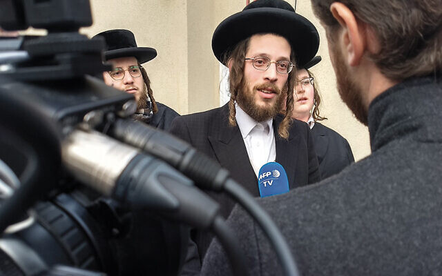 Josef Gluck speaks to reporters the day after the attack in Monsey on December 29, 2019. (Ben Sales)