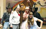 "The Beth Sholom Purimshpielers; from left, Adam Mathios, Gene Freyer, Matt Taragano, Normalee Sirota, Dawn Bernstein, and Caryn Friedland in ""The Wizard of Oz."""