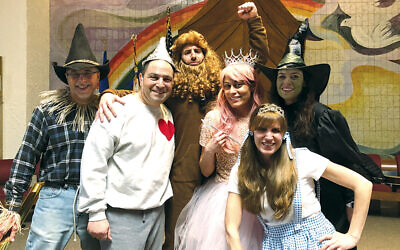 "The Beth Sholom Purimshpielers; from left, Adam Mathios, Gene Freyer, Matt Taragano, Normalee Sirota, Dawn Bernstein, and Caryn Friedland in ""The Wizard of Oz."""